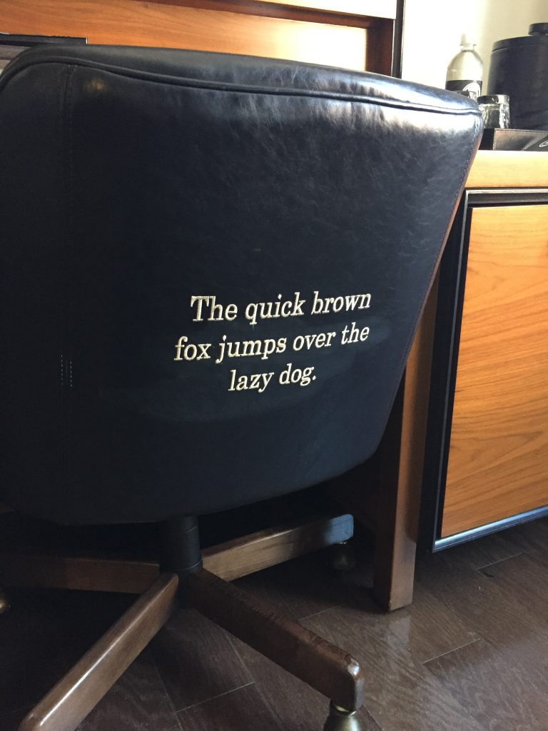 Type embroidered on a chair