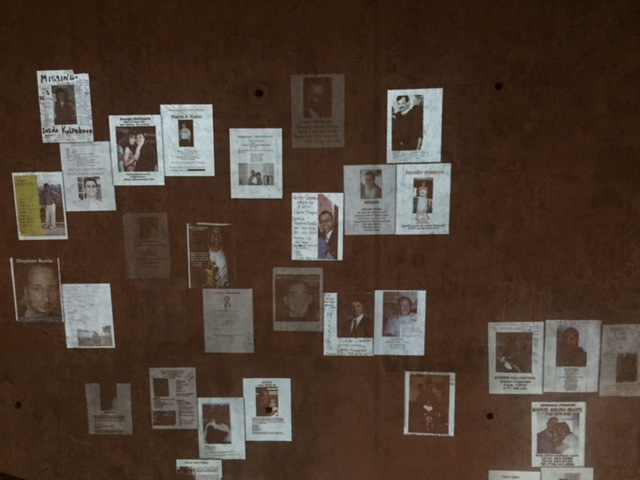 Missing posters projected on a wall at 9-11 Museum