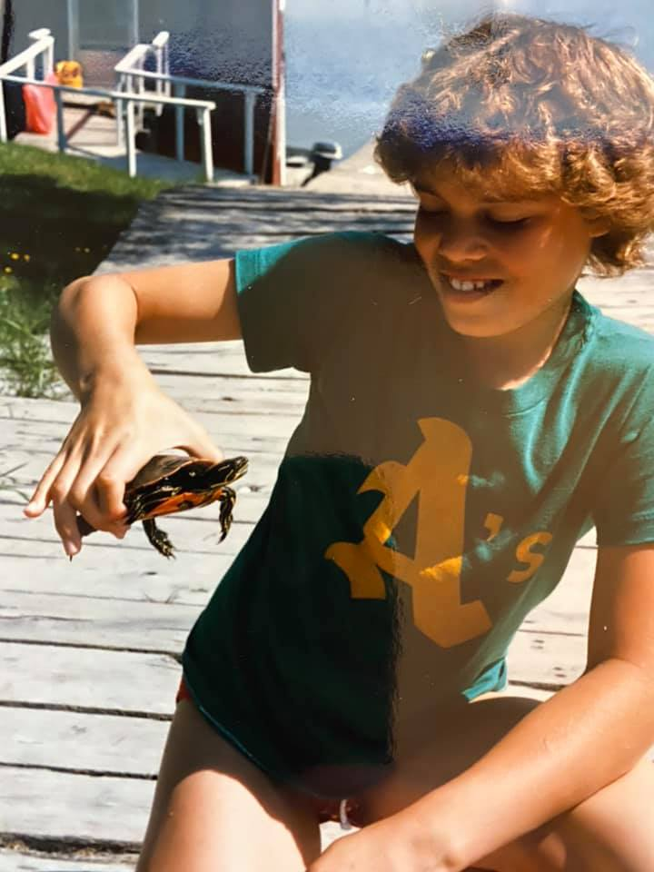 Me with a slider turtle in Sioux Narrows, Ontario Canada. Mid 1980s.